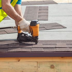 a roofer working on a flat roof