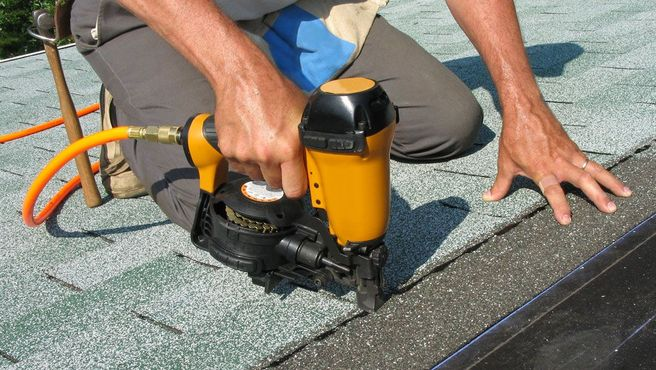 a flat roof being installed